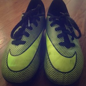 These are green and black soccer cleats.